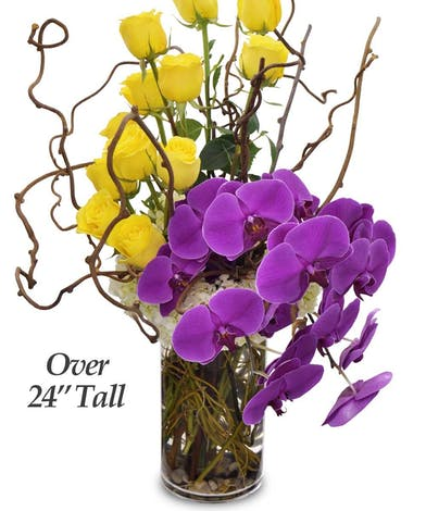 A tall vase design of one dozen yellow roses, orchids and hydrangea add to the old adage