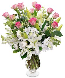 A large vase filled with roses, orchids and fragrant lilies!  Choose your rose color to make it an extra special gift!