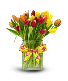 Vase filled with bright spring tulips