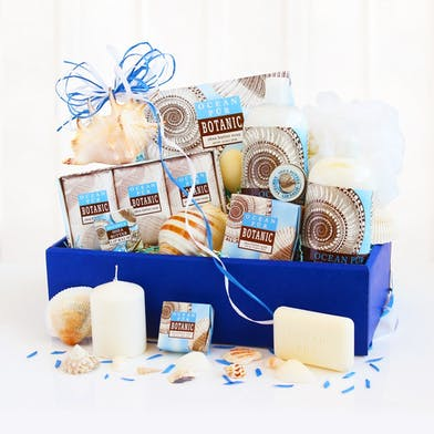 Gift basket filled with seashell-themed items.