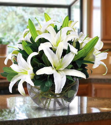 A unique bubble bowl filled with fragrant white lilies.
