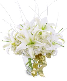 A wintry white bouquet of fragrant white lilies and hydrangea.