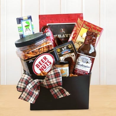 Gift basket filled with snacks, BBQ sauce and other goodies he'll love.