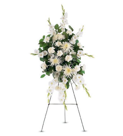 Funeral flowers standing spray of white carnations, chrysanthemums and gladioli.