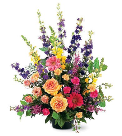 Bright basket of sympathy flowers appropriate for a service or for the home.