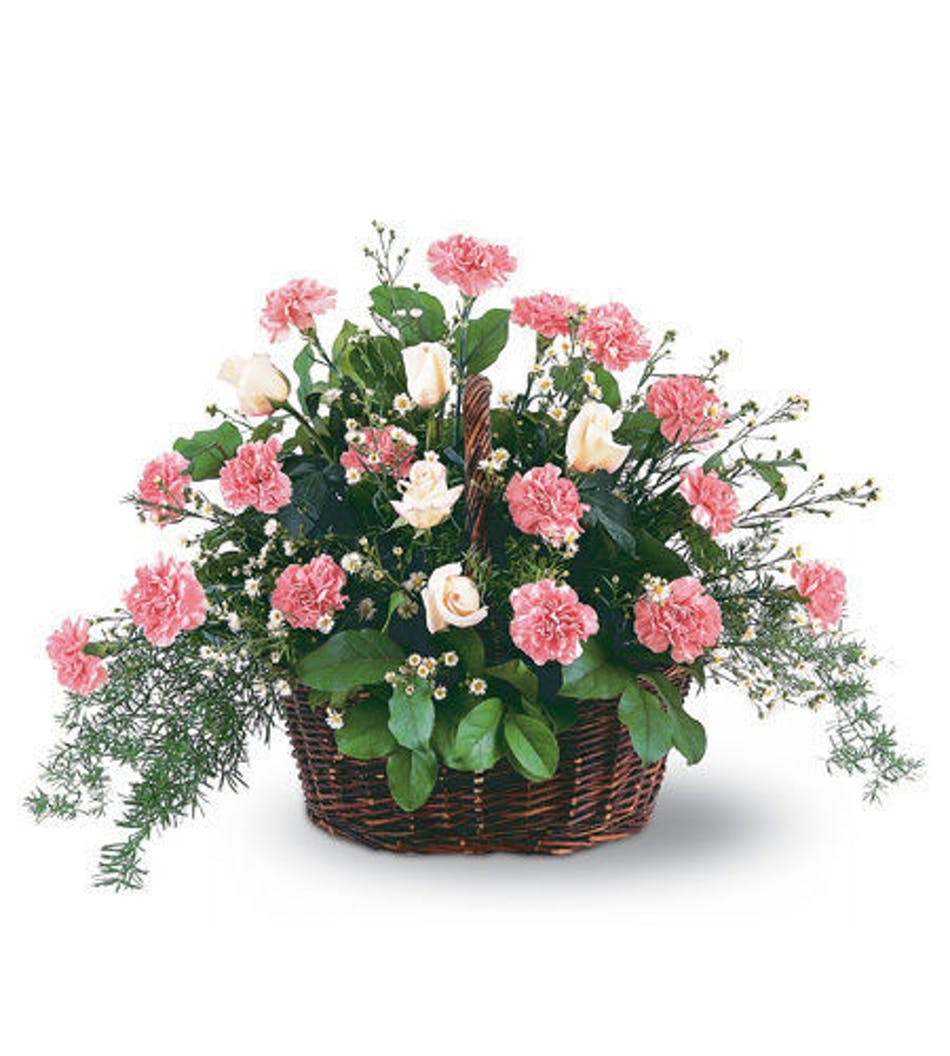 Pink reverence funeral tribute flowers fort worth florist basket filled with pink carnations in a sympathy arrangement mightylinksfo