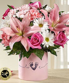 Pink vase of pink and white flowers.