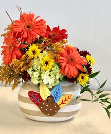 Coton Colors Happy Everything Thanksgiving jar filled with flowers.