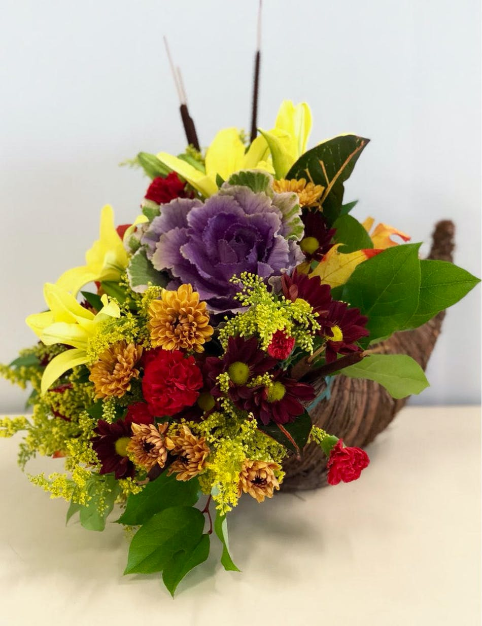 Cornucopia filled with fall flowers.
