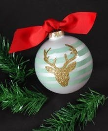 Ornament with glitter deer head decoration