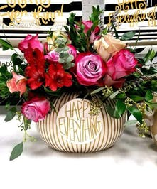 Cookie jar filled with roses, alstroemeria and greenery.