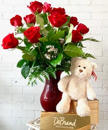 Say 'I Love You' with this sure-fire combination. One dozen beautiful Equadorian red roses arranged with a lovable teddy bear, chocolates, and a mylar balloon accents!