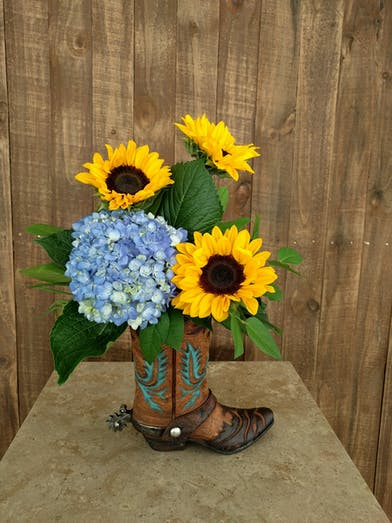 Sunflowers and hydrangea in a keepsake cowboy boot