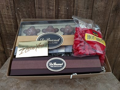 Gift box filled with turtles, truffles and other goodies.