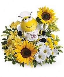 Plush bumblebee with sunflowers, daisies and alstroemeria.