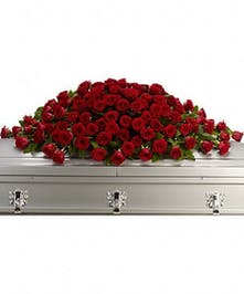 Casket spray of all red roses.