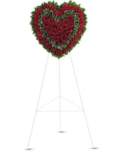 Red arrangement in a classic heart shape for sympathy or funeral services.