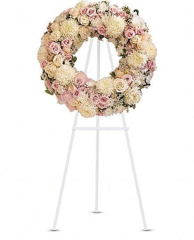Pastel sympathy wreath presented on an easel.