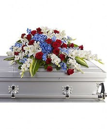 Red, white and blue casket flowers for a patriotic tribute.