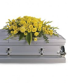 All-yellow casket spray of gladioli, mums, roses, daisies and greenery.
