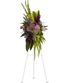 Sympathy spray of lavender flowers, purple stock, ywllow gladioli and green hydrangea.