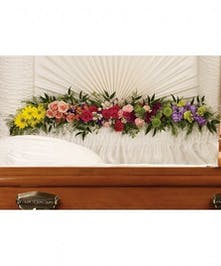Colorful casket garland of daisies, spray roses, carnations and more.