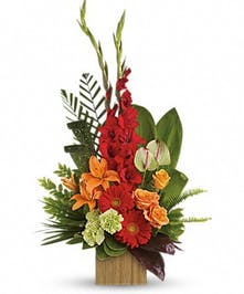 Bamboo container with roses, Asiatic lilies, anthuriums, gerberas, gladioli and carnations.