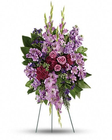 Funeral flowers standing spray of lavender and purple flowers.