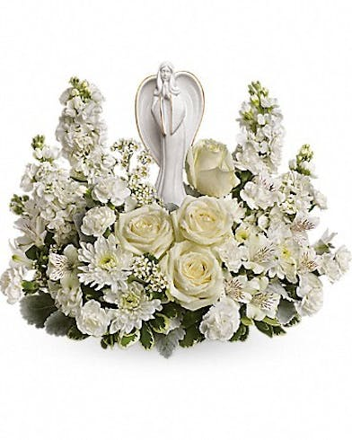 Angel keepsake sculpture surrounded by white roses, alstroemeria and stock.