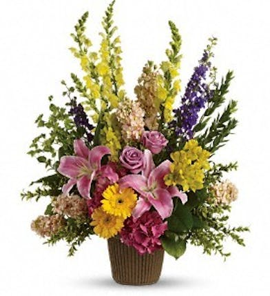 Sympathy arrangement of pink hydrangea, lavender roses, pink lilies and more.