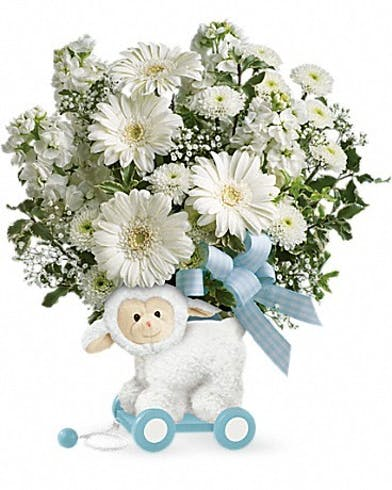 Lamb container filled with all-white flowers and a blue bow.
