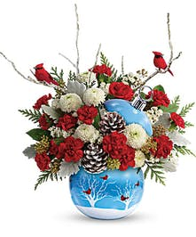 Cardinal ornament vase filled with red and white flowers and cardinal accents