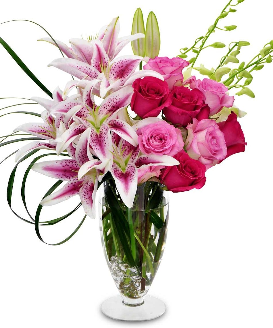 Fort worth flower delivery turn up the pink gordon boswell flowers pink lilies and roses with white orchids in a clear glass vase izmirmasajfo