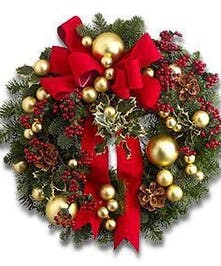 Evergreen wreath adorned with ornaments and a red bow.