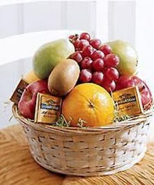 Gift basket filled with seasonal fruit and chocolate.