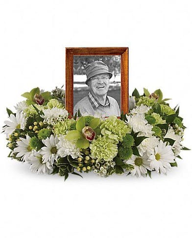 Wreath of white chrysanthemums, green cymbidium orchids and carnations. For urn or photograph.