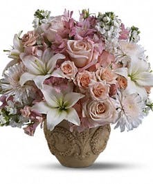 Elegant container of white lilies, pink roses and alstroemeria.
