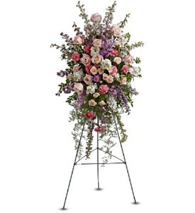 Sympathy spray of roses, carnations, delphinium and more.