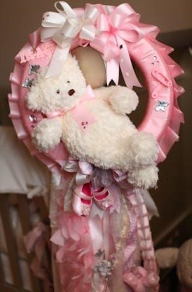 Baby door badge in pink.
