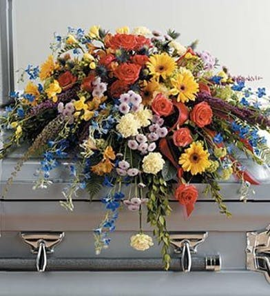 Casket flowers in bold colors.