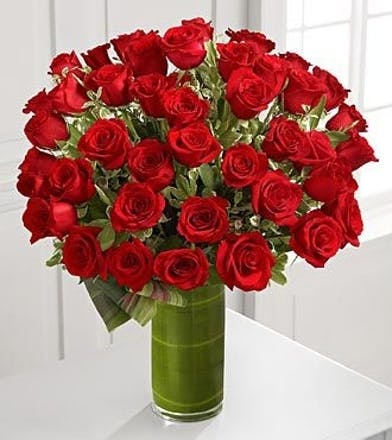48 hand selected red roses, perfectly arranged with assorted greens. Stunning!