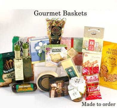 Gift basket filled with mixed nuts, cookies, crackers, cheese spreads, and more.