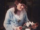 An early-century portrait of Mrs. Boswell, arranging flowers in the shop
